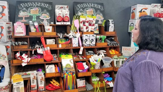 Owner Mary Beth Guard shows off some of her favorite baking gadgets at Capers Emporium.