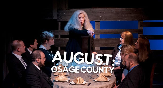 "The cast sitting at dinner during the performance ""August: Osage County""."