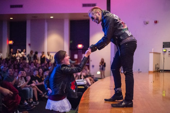 Professional Drag King, Spikey Van Dykey, accepts tips from the crowd during his performance of 'Freedom' by George Michael on Friday, August 31, Tallahassee, FL., August 31, Tallahassee, FL.