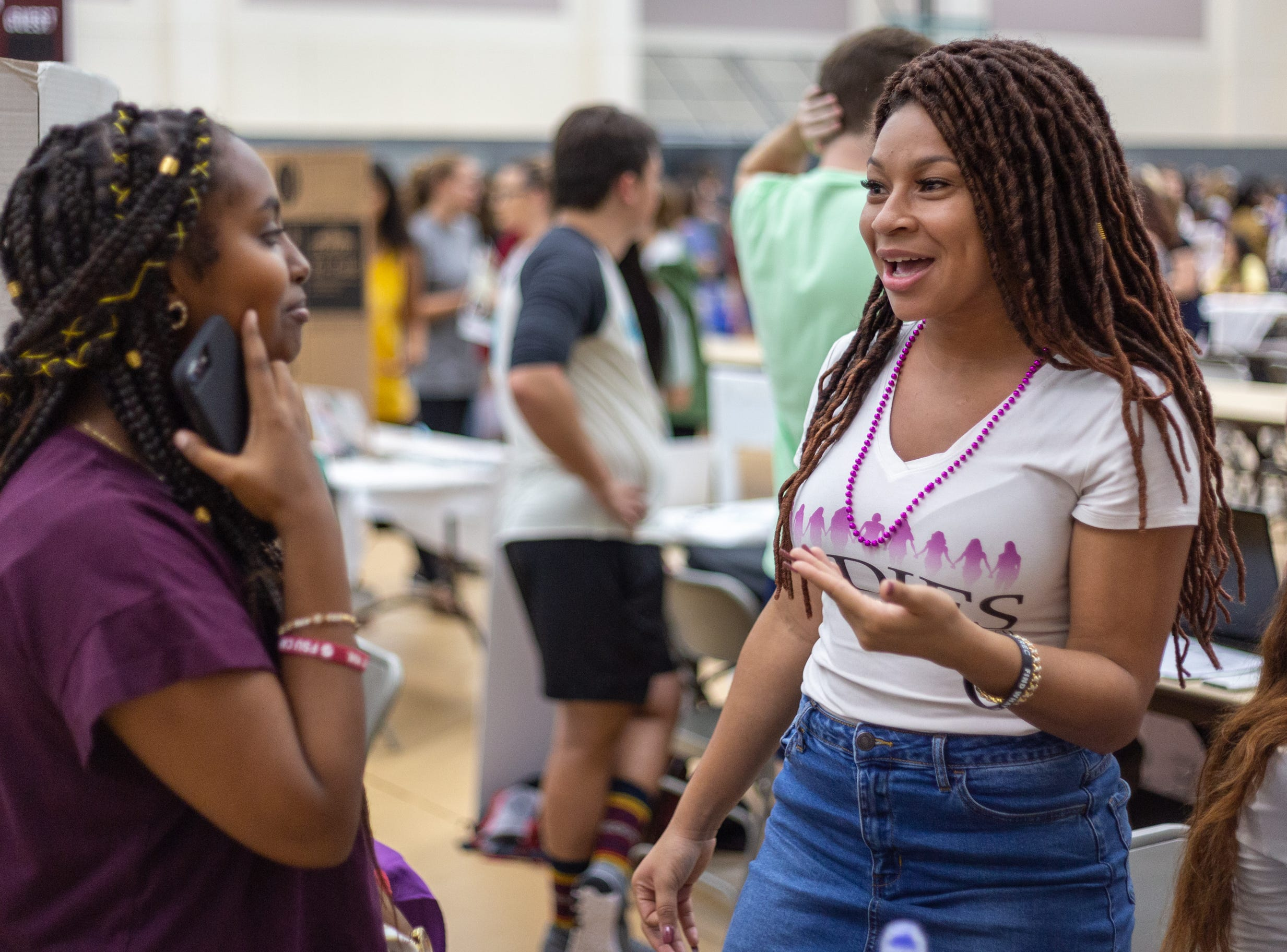 Wendyvette Edwards (right), president of LADIES speaks to a prospective club member on Tuesday, August 29th at FSU's Involvement Fair in the Tully Gymnasium, Tallahassee, FL.