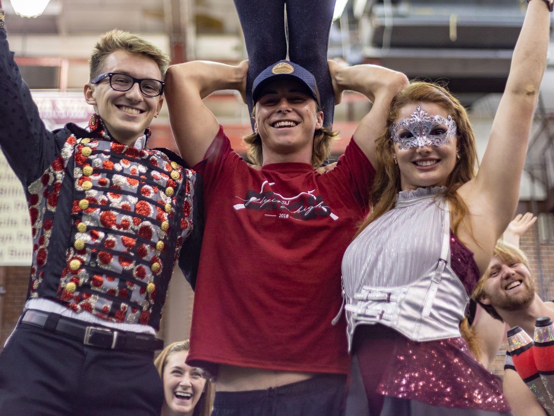 Anshley Sanders (top), Adam Rhodes (left), Dalton Leclair (center), and Brooke Garringer (right) show off their circus skills on Tuesday at FSU's Involvement Fair in the Leach Center.