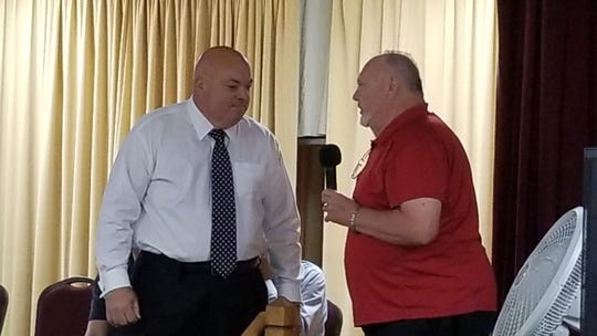 Alan Neidermeier, a member of the board a the Lehigh Acres Senior Center, introduces County  Commissioner Cecil Pendergrass who announced the county will fund the center, saving it from closing at the end of the year.