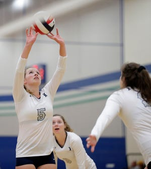 Xavier's Emma Vosters (5) passes the ball at the Tom Larsen Triton Classic at Notre Dame High School on Saturday.