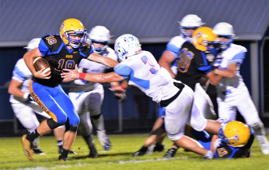 Southern Door's Derik Lecaptain (33) fights through a block to make a play on Oconto quarterback Zach Sherman in the seconnd quarter of the game on Friday, Aug. 31.