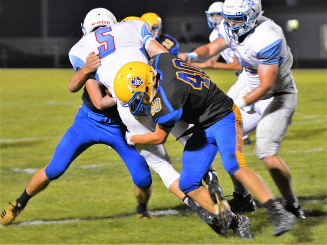 Oconto's Eddie Russell tackles Southern Door's Nick Baudhuin (5) in the third quarter action of the game on Friday.