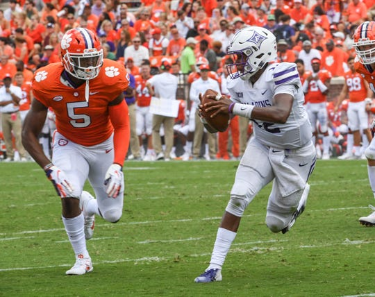 Clemson linebacker Shaq Smith (5) chases Furman quarterback JeMar Lincoln (12) during the second quarter in Memorial Stadium in Clemson on September 1.