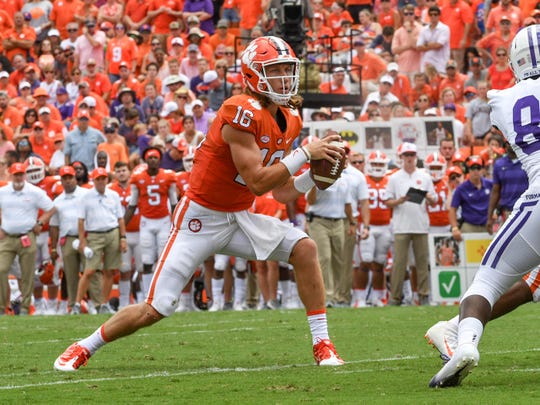 Clemson quarterback Trevor Lawrence (16) fakes before throwing a touchdown against Furman during the third quarter in Memorial Stadium in Clemson on September 1.