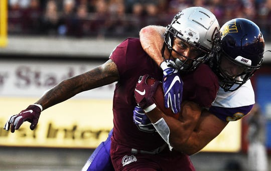 Northern Iowa linebacker Duncan Ferch makes an open-field tackle on University of Montana wide receiver Keenan Curran during the first half of an NCAA college football game in Missoula, Mont., Saturday, Sept. 1, 2018. (Colter Peterson/The Missoulian via AP)