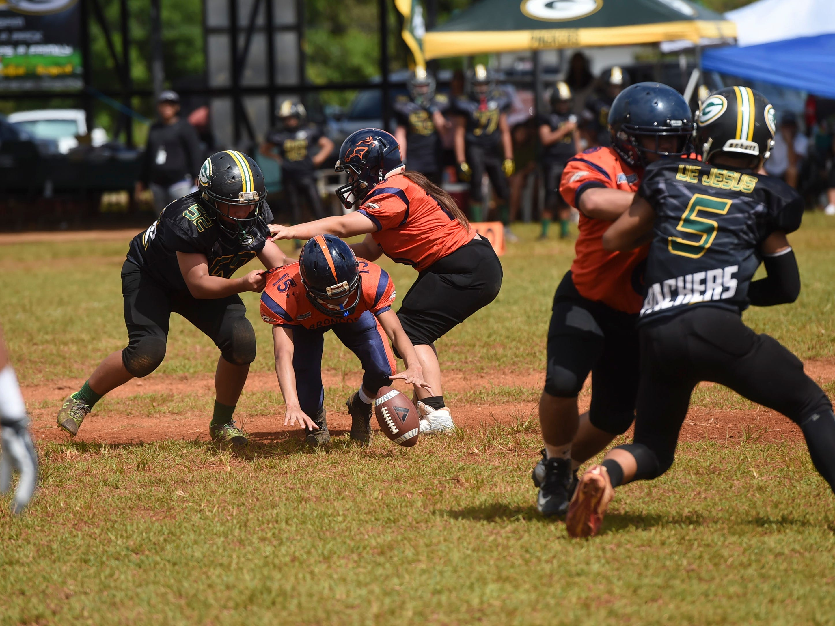 Cinnabon Island Broncos player Ipo Aguon Indalecio (15) dives for the ball the ball against the Guam Packers during their Guam National Youth Football Federation Matua division game at the Mikkel Tan I. Vy Field in Tiyan on Sept. 2, 2018.
