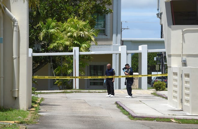 Guam Police Department officers investigate in a blocked off area where a man was found unresponsive by a security guard at the University of Guam campus on Sept. 2, 2018.