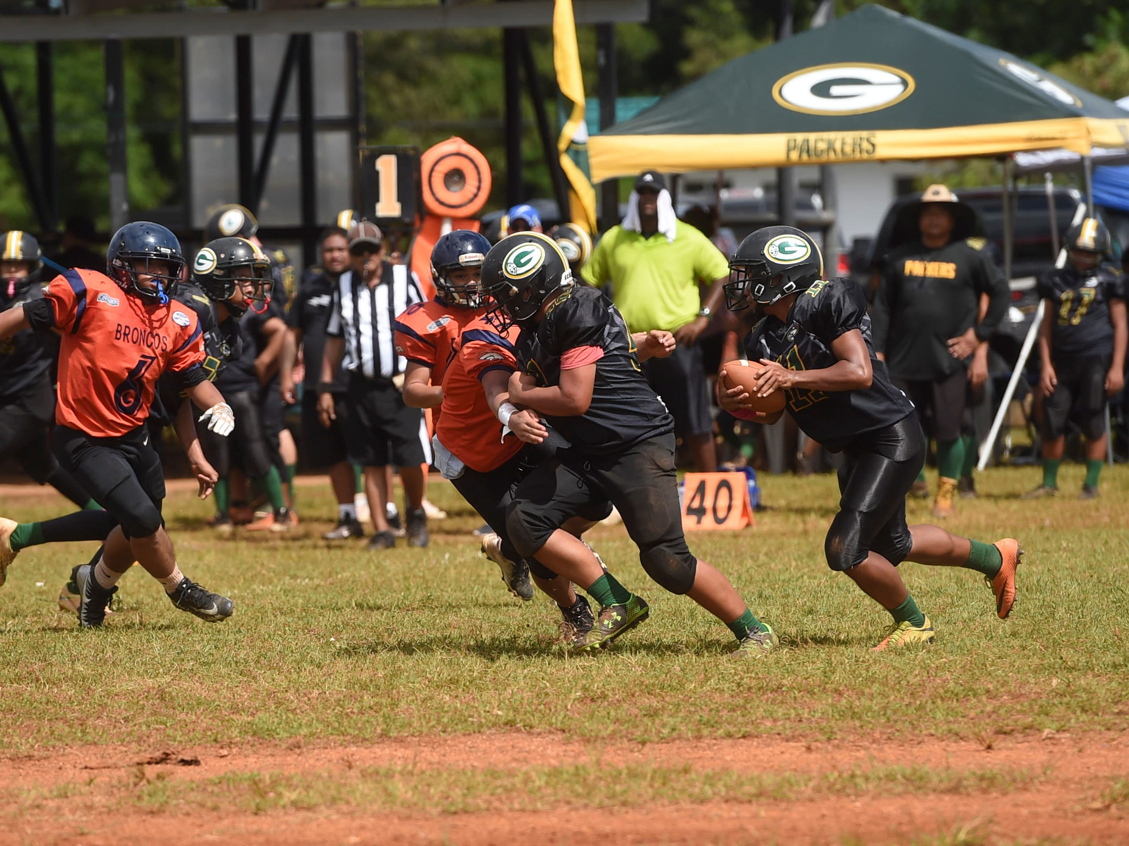 The Guam Packers faced the Cinnabon Island Broncos in a Guam National Youth Football Federation Matua division matchup at the Mikkel Tan I. Vy Field on Sept. 2, 2018.
