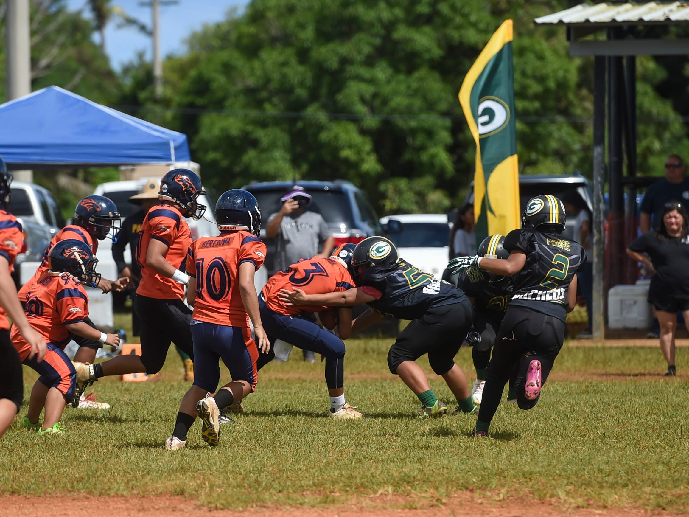 Cinnabon Island Broncos and Guam Packers players collide during their Guam National Youth Football Federation Matua division game at the Mikkel Tan I. Vy Field in Tiyan on Sept. 2, 2018.