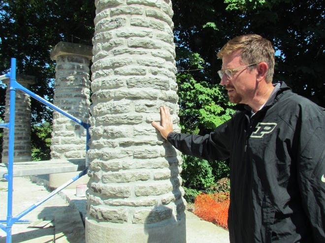 Landscape architect Barth Hendrickson oversees the reconstruction of Riverdale, Jens Jensen's century-old landscape at Allison Mansion on the Marian University campus. The stone pillars are part of a historic colonnade.