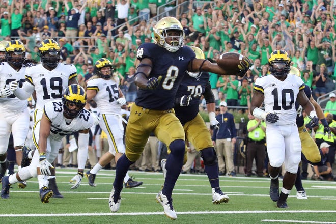 Notre Dame Fighting Irish running back Jafar Armstrong (8) runs for touch down against Michigan Wolverines at Notre Dame Stadium in South Bend, Ind.,on Saturday, September 1, 2018