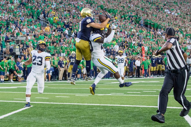 Sep 1, 2018; South Bend, IN, USA; Notre Dame Fighting Irish wide receiver Chris Finke (10) catches a pass for a touchdown over Michigan Wolverines defensive back Brad Hawkins (20) in the first quarter at Notre Dame Stadium. Mandatory Credit: Matt Cashore-USA TODAY Sports