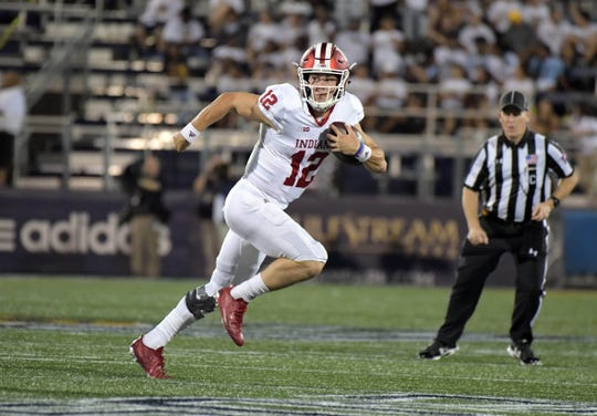 Indiana Hoosiers quarterback Peyton Ramsey (12) carries the ball against the FIU Golden Panthers at Riccardo Silva Stadium. Indiana defeated FIU 38-28.