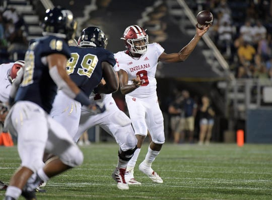 Hoosiers quarterback Michael Penix Jr. (9) throws a pass under pressure from FIU Golden Panthers defensive lineman Jermaine Sheriff (99) in the third quarter at Riccardo Silva Stadium. Indiana defeated FIU 38-28.