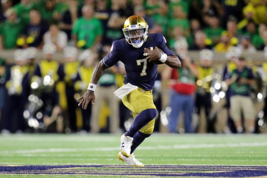 Notre Dame Fighting Irish quarterback Brandon Wimbush (7) runs for first down against Michigan Wolverines at Notre Dame Stadium in South Bend, Ind.,on Saturday, September 1, 2018