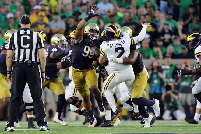 The Notre Dame Fighting Irish defense stops Michigan Wolverines quarterback Shea Patterson (2) on third down In the second half. Notre Dame defeats the Michigan Wolverines 24-17 at Notre Dame Stadium in South Bend, Ind.,on Saturday, September 1, 2018
