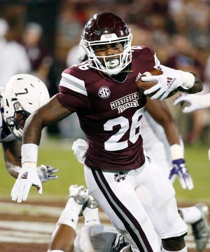 Mississippi State running back Aeris Williams (26) looks for running room against Stephen F. Austin in an NCAA college football game, Saturday, Sept. 1, 2018, in Starkville, Miss. Mississippi State won 63-6. (AP Photo/Rogelio V. Solis)