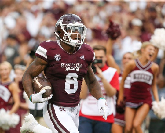 Mississippi State's Kylin Hill (8) runs for a 53-yard touchdown on a pass from Mississippi State's Keytaon Thompson. Mississippi State played Stephen F. Austin in the 2018 football season opener at Davis-Wade Stadium in Starkville on September 1, 2018. Photo by Keith Warren/Mandatory Credit