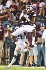 Sep 1, 2018; Starkville, MS, USA; Mississippi State Bulldogs wide receiver Stephen Guidry (1) attempts to make a catch against Stephen F. Austin Lumberjacks cornerback Davelle Fox (21) during the third quarter at Davis Wade Stadium. Mandatory Credit: Matt Bush-USA TODAY Sports