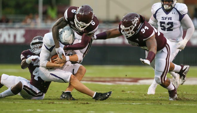 Mississippi State's Willie Gay Jr. (6), Mississippi State's Jeffery Simmons (94)  and Mississippi State's Gerri Green tackle Stephen F. Austin's Josh Covey (11) in the first quarter. Mississippi State played Stephen F. Austin in the 2018 football season opener at Davis-Wade Stadium in Starkville on September 1, 2018. Photo by Keith Warren/Mandatory Credit