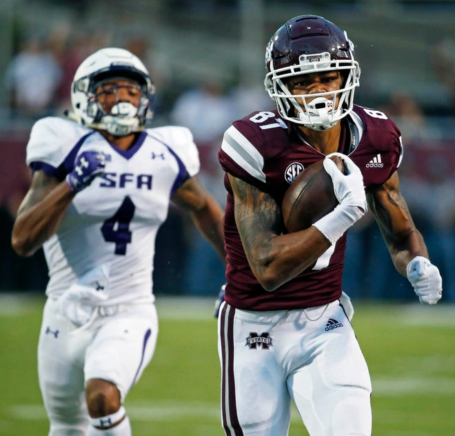 Mississippi State wide receiver Osirus Mitchell (87) runs past Stephen F. Austin safety Chris James (4) for a 84-yard touchdown pass reception during the first half of their NCAA college football game, Saturday, Sept. 1, 2018, in Starkville, Miss. (AP Photo/Rogelio V. Solis)
