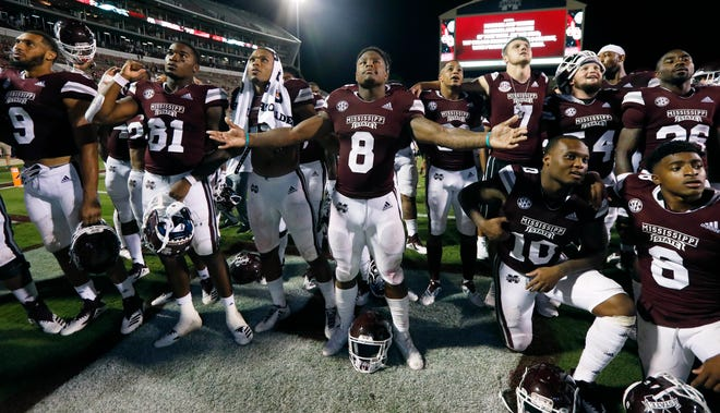 Mississippi State running back Kylin Hill (8) leads his teammates in singing the school song following their 63-6 win in their NCAA college football game against Stephen. F. Austin, Saturday, Sept. 1, 2018, in Starkville, Miss. (AP Photo/Rogelio V. Solis)