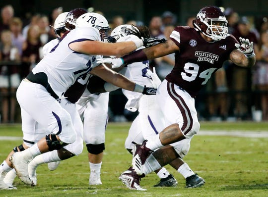 Mississippi State defensive tackle Jeffery Simmons (94) pushes through a double team of Stephen F. Austin offensive linemen on a play during the first half of their NCAA college football game, Saturday, Sept. 1, 2018, in Starkville, Miss. (AP Photo/Rogelio V. Solis)