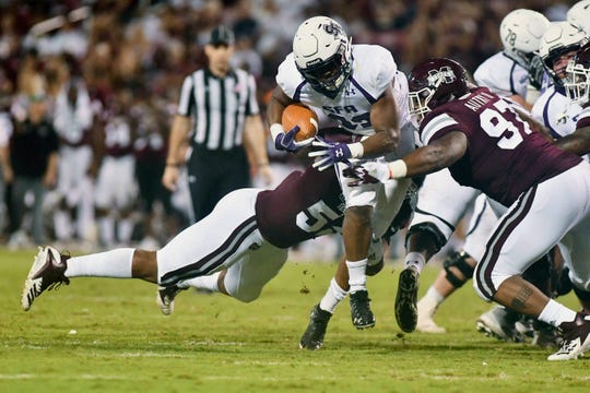Sep 1, 2018; Starkville, MS, USA; Mississippi State Bulldogs defensive end Kobe Jones (52) and defensive tackle Lee Autry (97) attempt to stop a run by Stephen F. Austin Lumberjacks  running back Jamall Shaw (32) during the third quarter at Davis Wade Stadium. Mandatory Credit: Matt Bush-USA TODAY Sports