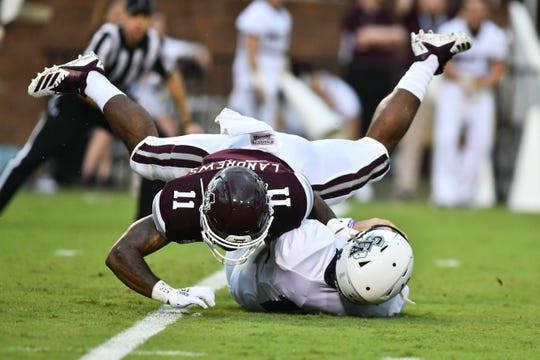 Sep 1, 2018; Starkville, MS, USA; Mississippi State Bulldogs safety Jaquarius Landrews (11) sacks Stephen F. Austin Lumberjacks quarterback Foster Sawyer (12) during the first quarter at Davis Wade Stadium. Mandatory Credit: Matt Bush-USA TODAY Sports