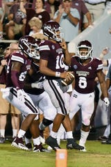Sep 1, 2018; Starkville, MS, USA; Mississippi State Bulldogs quarterback Keytaon Thompson (10) reacts after running for a 25 yard touchdown during the fourth quarter against the Stephen F. Austin Lumberjacks at Davis Wade Stadium. Mandatory Credit: Matt Bush-USA TODAY Sports