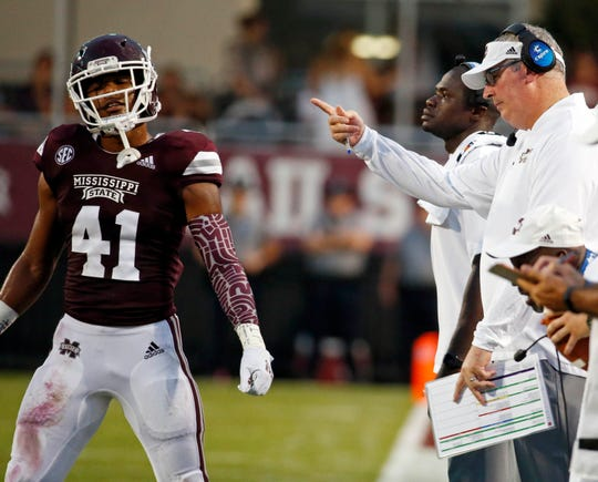Mississippi State head coach Joe Moorhead directs safety Mark McLaurin (41) back to the field during the first half of their NCAA college football game against Stephen F. Austin, Saturday, Sept. 1, 2018, in Starkville, Miss. (AP Photo/Rogelio V. Solis)