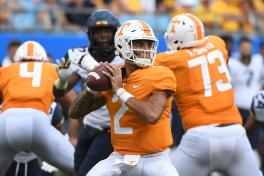 Tennessee quarterback Jarrett Guarantano (2) lines up a pass during the Belk College Kickoff between Tennessee and West Virginia at Bank of America Stadium in Charlotte, North Carolina on Saturday, September 1, 2018.