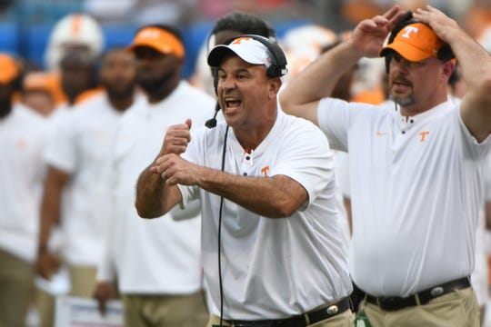 Tennessee Head Coach Jeremy Pruitt calls during the Belk College Kickoff between Tennessee and West Virginia at Bank of America Stadium in Charlotte, North Carolina on Saturday, September 1, 2018.