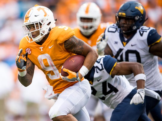 Tennessee running back Tim Jordan (9) runs downfield during the Tennessee Volunteers' game against West Virginia in the Belk College Kickoff at Bank of America Stadium in Charlotte, N.C., on Saturday, Sept. 1, 2018.