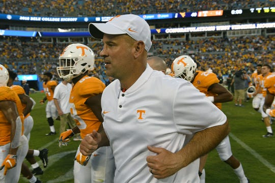 Tennessee Head Coach Jeremy Pruitt leaves the field after their 40-14 loss to West Virginia in the Belk College Kickoff game in Charlotte, NC Saturday, September 1, 2018.