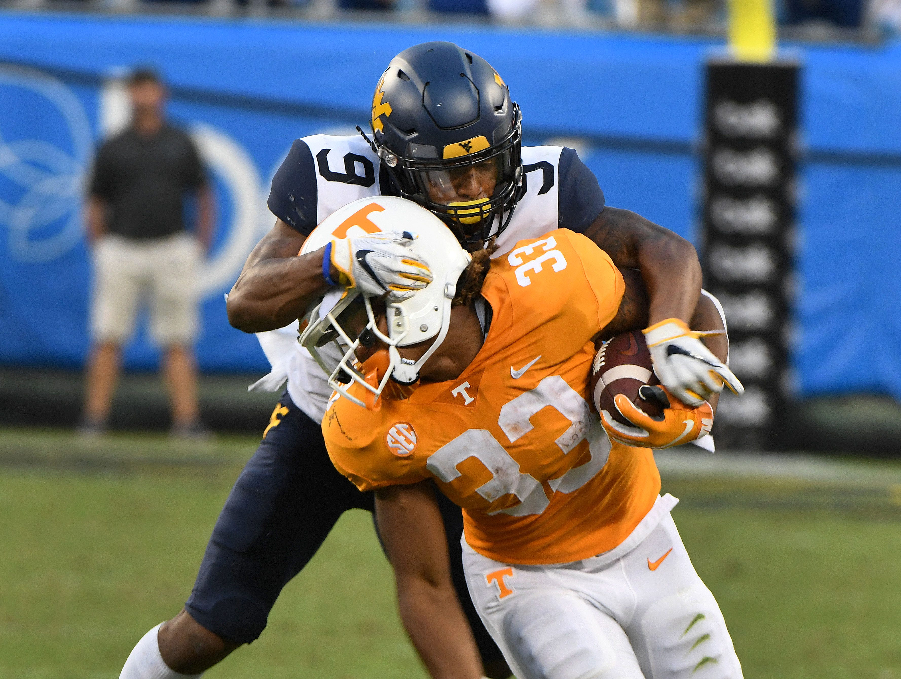 Tennessee running back Jeremy Banks (33) is tackled by West Virginia JoVanni Stewart (9) during the final minutes of their 40-14 loss to West Virginia in the Belk College Kickoff game in Charlotte, NC Saturday, September 1, 2018.