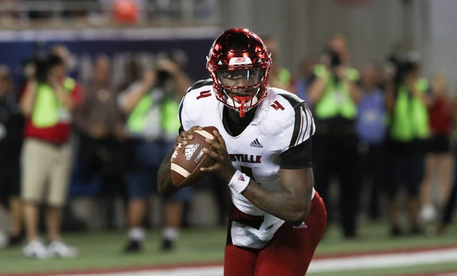 U of L QB Jawon Pass (4) looked to pass against Alabama during their game at Camping World Stadium in Orlando. Sep. 1, 2018