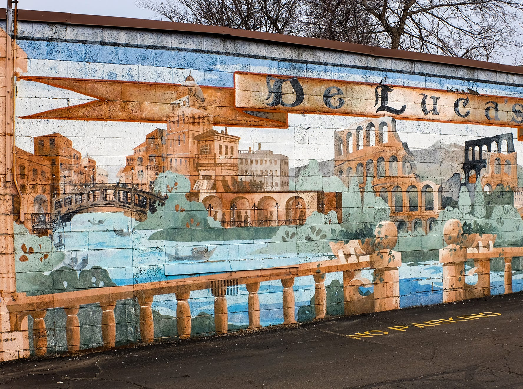 The mural at DeLuca's on Willow Street in Lansing was created by Gary Glenn in 1998 and is one of the oldest in Lansing.