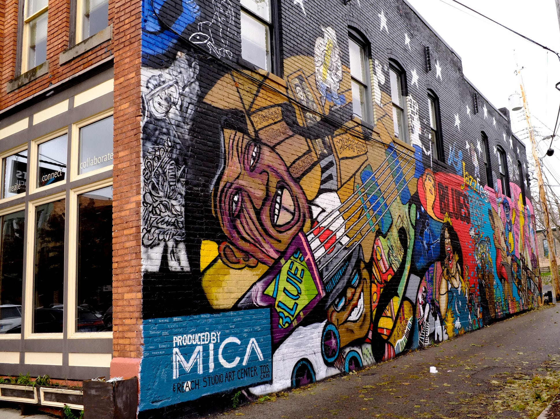 This prominent mural by MICA and Reach Studio Art Center is behind the 300 block of E. Cesar Chavez Avenue and Turner Street.