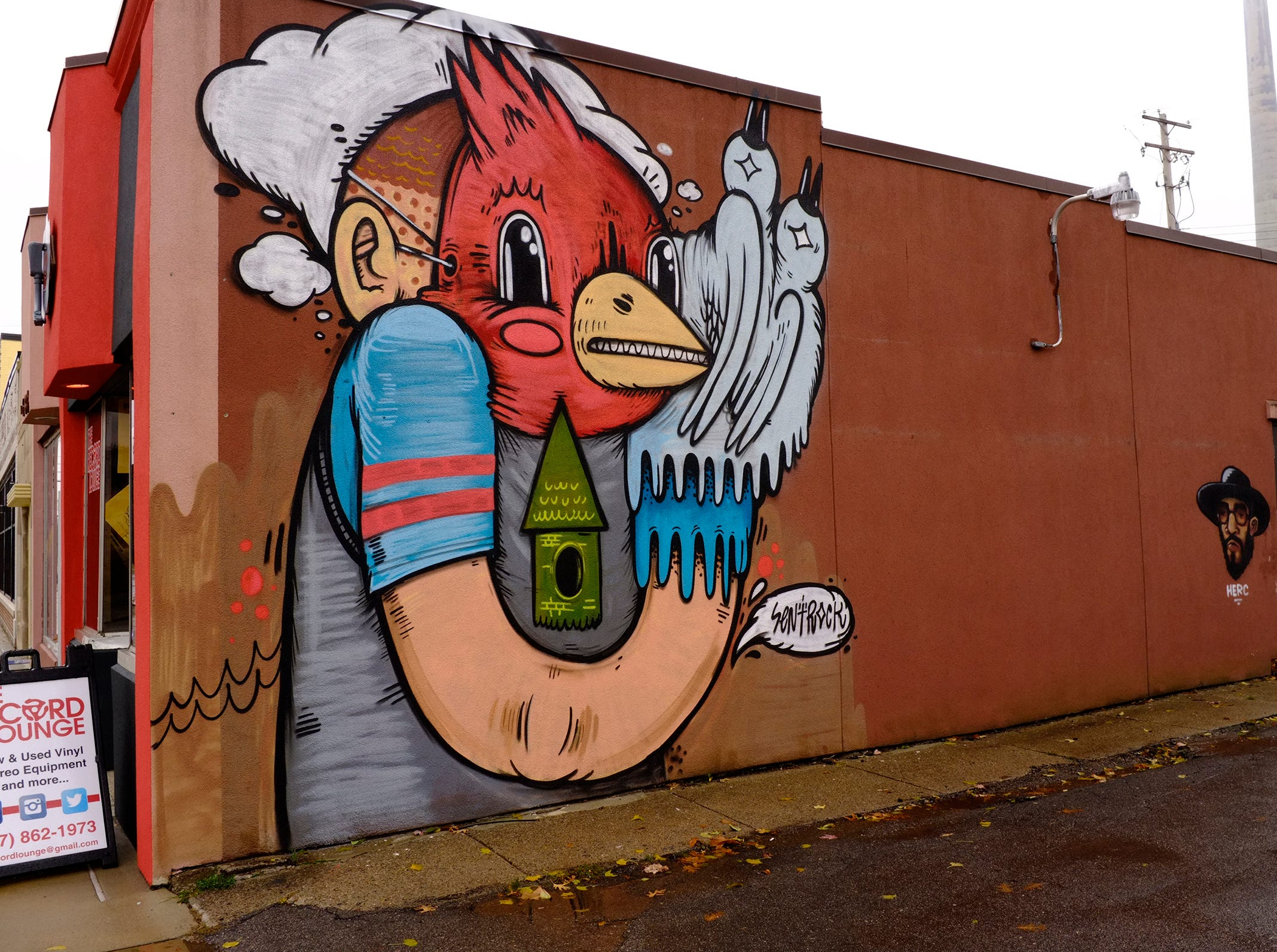 A signature mural by Sentrock out of Chicago is painted on the side of The Record Lounge in Lansing's Reo Town.