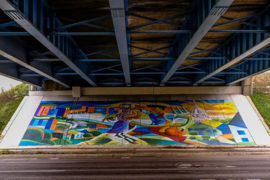 """A mural project entitled """"Under the Bridge"""" by Brian Whitfield graces the sloping walls of the I 496 overpasses over Michigan Avenue in Lansing."""
