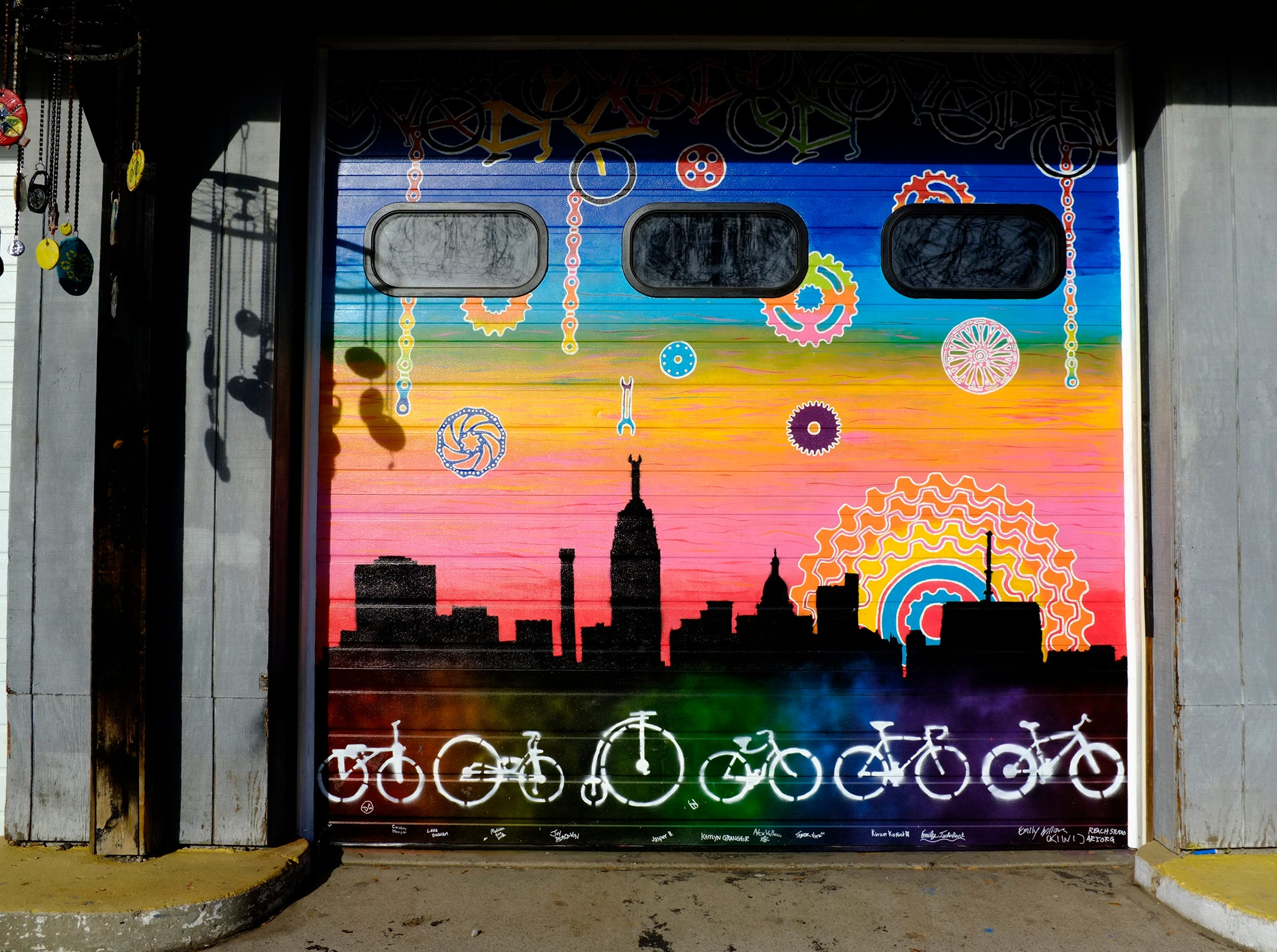 This bike shop on Kalamazoo Street in Lansing sports a mural created by Reach Studio.