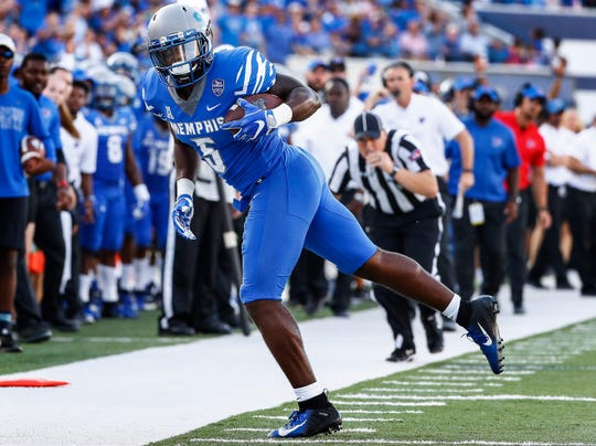 Memphis tight end Sean Dykes makes a first down catch against the Mercer defense during their college football game at The Liberty Bowl Memorial Stadium in Memphis, Tenn., Saturday, September 1, 2018.