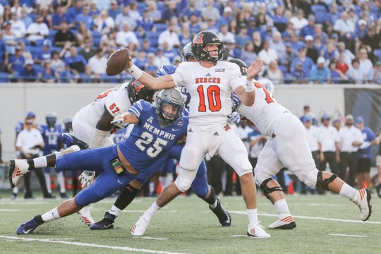 September 01 2018 - Memphis' Austin Hall nearly sacks Mercer's quarterback, Robert Riddle, during Saturday's game versus Mercer at the Liberty Bowl Memorial Stadium.