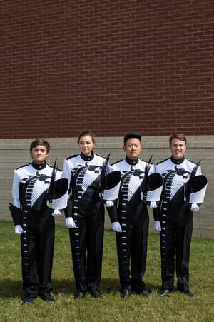 From left, David Johnson, Makenna Whitmer, Joshua Park and Jacob London, senior drum majors, pose for a picture with their new uniforms before practice at Collierville High School on Aug. 31, 2018. The Collierville High School marching band is preparing to host the Tournament of Champions competition Sept. 29.