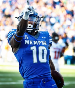 Memphis receiver Damonte Coxie celebrates a touchdown against the Mercer defense during their college football game at The Liberty Bowl Memorial Stadium in Memphis, Tenn., Saturday, September 1, 2018.