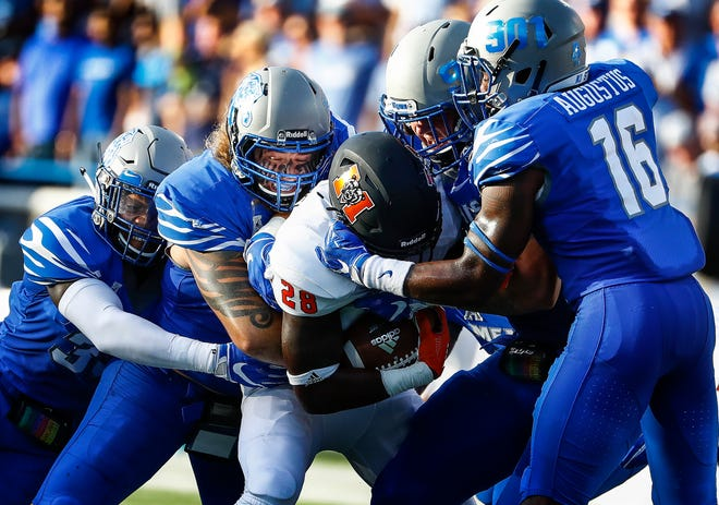 The Memphis defense brings down Mercer running back Tee Mitchell (middle) for a loss during their college football game at The Liberty Bowl Memorial Stadium in Memphis, Tenn., Saturday, September 1, 2018.